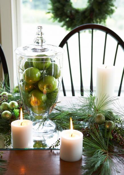 Centro con velas y manzanas