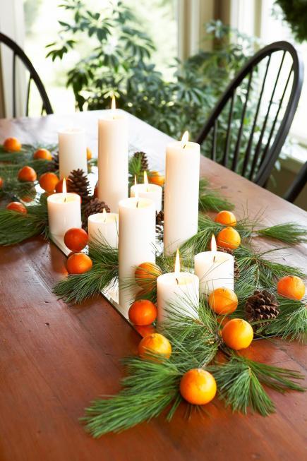 Centro con velas y naranjas