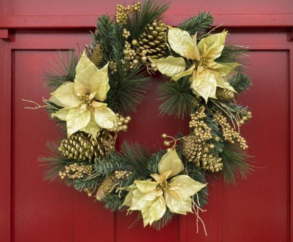 Christmas wreath on red painted door