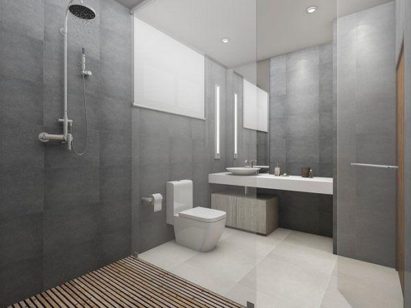 plato de ducha moderno y amplio lavabo con encimera supletoria y vter todo combinado con un gris claro en sus paredes que luce de maravilla