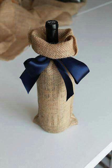 Cómo envolver regalos de Navidad botella saco