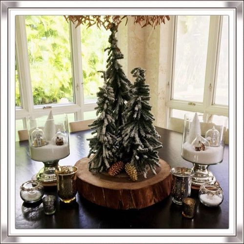 Centro de mesa de tronco con abetos nevados