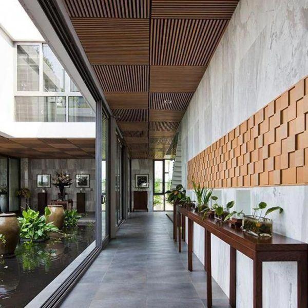 Como decorar pasillo patio suelo gres mueble plantas